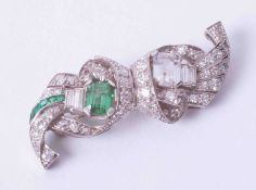 A diamond and emerald brooch set in platinum, (two main stones are paste).