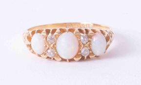 18ct yellow gold three stone opal & diamond gypsy style ring, finger size R.