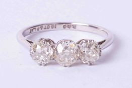 An 18ct and platinum diamond three stone ring, approx 1.20 carats, size N.