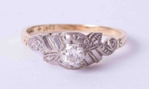 An 18ct and platinum diamond single stone ring, fancy raised setting, size L.