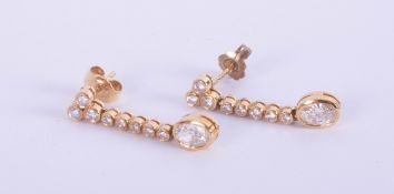 A pair 18ct yellow gold drop earrings, set with small oval brilliant cut diamonds, and further