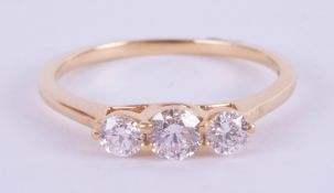 An 18ct yellow gold trilogy ring approx. 0.50ct, estimated colour and clarity E/SI1, ring size M.