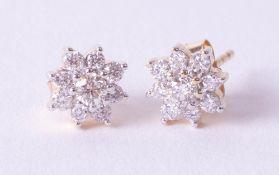 A pair of 18ct diamond set cluster earrings.