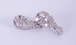 A pair white gold Art Deco style clip on earrings of leaf design.