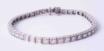 A fine 18ct white gold and diamond set line bracelet, diamond weight approx. 4.00 carats.