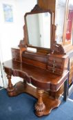 A Victorian mahogany 'Duchess' dressing table.