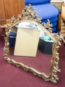 A reproduction gilt framed mantle mirror.