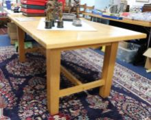 A good quality light oak refectory dining table, purchased from Codrington Furniture, London SW8,