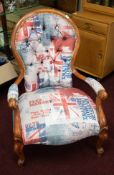 Four reproduction wood framed arm chairs, each decorated in a contemporary GB fabric together with a