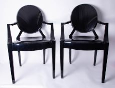 A pair of black Louis Ghost Armchairs by Kartell.