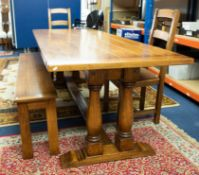 Brights of Nettlebed, a good quality oak 'trestle' table of antique style together with a long bench