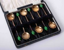Cased set of six Art Deco gold plated cocktail spoons, with shell bowl and olive stems, each spoon