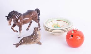 A Beswick horse, four Clarice Cliff cereal bowls, a Beswick seal and a marmalade pot.