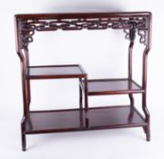 A Chinese rosewood stand with two tiers, height 74cm, width 72cm, depth 30cm.
