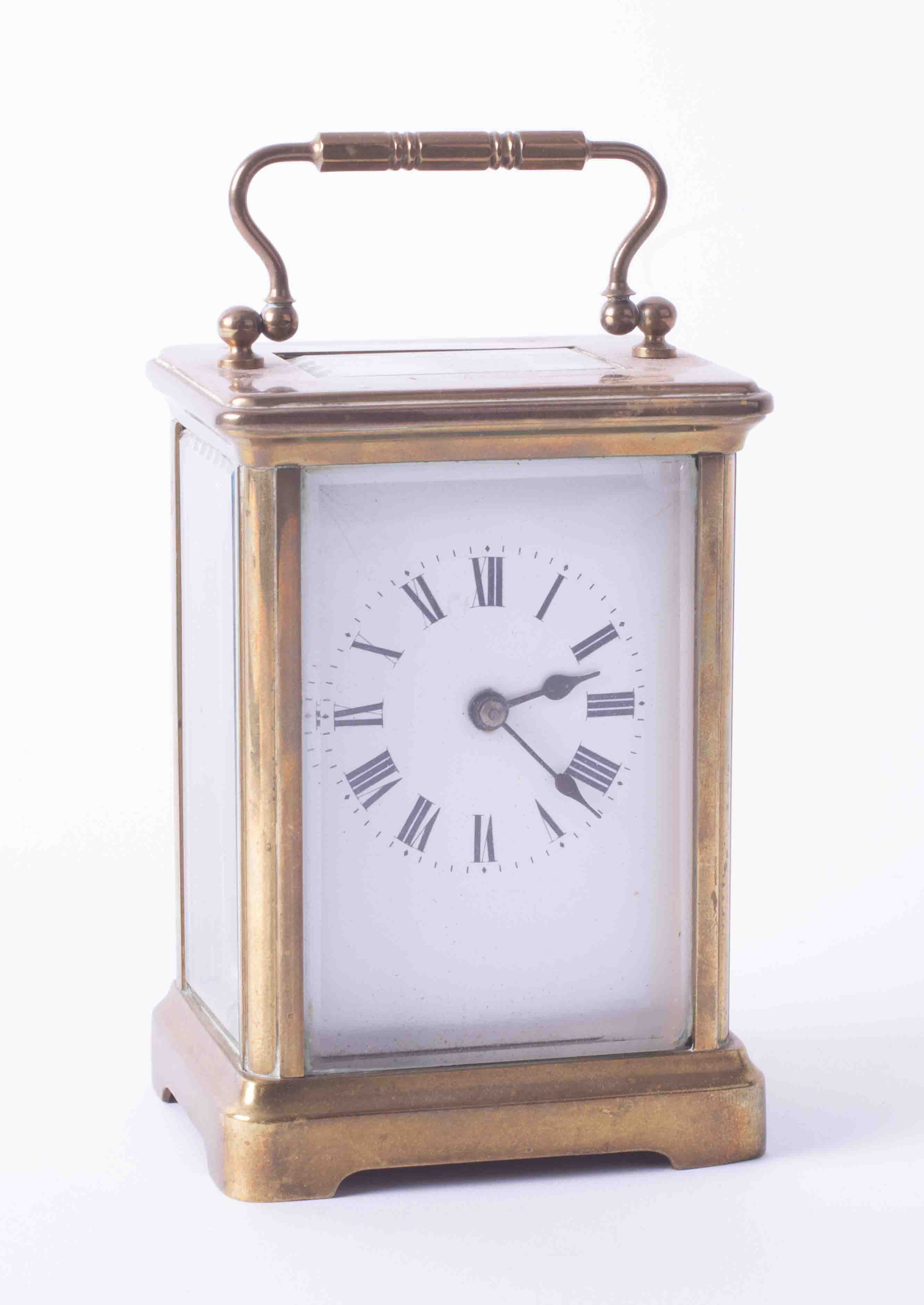 A French brass faced carriage clock with platform escapement, two keys, hairline crack to dial.