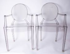 A pair of clear Louis Ghost Armchairs by Kartell.