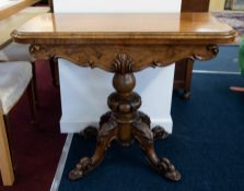 A Victorian walnut fold over card table on pedestal base, width 94cm.