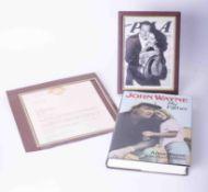 A collection of John Wayne memorabilia including John Wayne My Father book, John Wayne framed