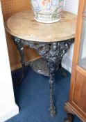 A heavy cast iron pub table possibly 19th Century with lion paw feet, with crests of Britannia?