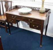 A writing table with fret work gallery.