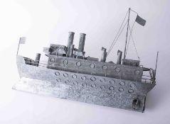 A tin model of a Great War battleship, length 65cm.