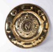An antique circular brass alms dish.