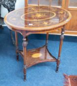 A mahogany oval occasional table with two tiers, the top with decorative marquetry style inlay and