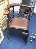 A oak carved corner chair.