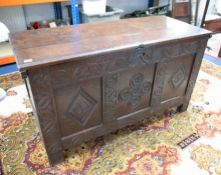 An 18th Century carved oak coffer.