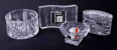 A modern Waterford Crystal wavelength clock, Champagne bottle coaster, overture oval box and