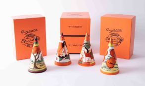 A Wedgwood set of four Clarice Cliff Bizarre conical sugar sifter, from the Clarice Cliff