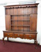 A large antique oak dresser (two sections).
