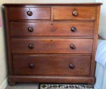 An early 20th Century mahogany straight front chest of drawers fitted with five drawers.