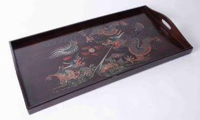 A Chinese lacquered tray decorated with dragons, 20th Century marked Kien Sing & Co, Foochow, China,