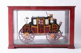 A cased model of a Stage Coach, 'Coventry to Chester', the cabinet 39cm x 25cm x 18cm.