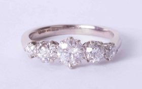 An 18ct white gold diamond five stone ring, total diamond weight approx. 1.75 carats, size S.