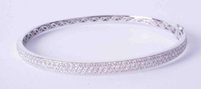 A fine 18ct white gold pave set diamond bangle, approximately 19.3g.