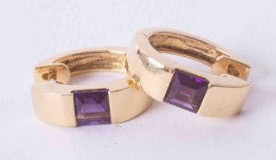 A pair of 18ct yellow gold hoop earring set square cut amethysts, 8.1g.