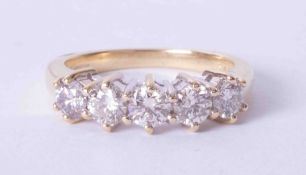 An 18ct yellow gold claw set diamond five stone ring approx. 1.25 carats (total weight), finger size