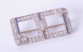 An Art Deco diamond and sapphire brooch with a mixture of round and baguette cut stones, 35mm x
