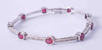 An 18ct white gold and ruby fancy bracelet, set approx. 3.15 carats of oval cut rubies interspaced