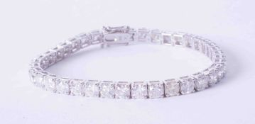 A stunning 18ct white gold diamond line bracelet, approx. total weight 12.60 carats, 38 diamonds,