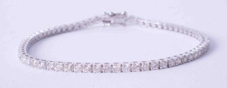 An 18ct white gold claw set diamond line bracelet, total weight approx. 3 carats, length 18cm.
