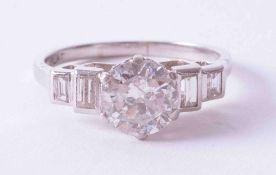 An impressive Art Deco platinum ring, set approx. 1.65 carat round cut diamond, colour G-H,