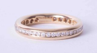 An 18ct yellow gold diamond full band eternity ring, finger size M 1/2.