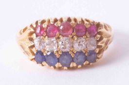 An antique 18ct yellow gold three row ring set rubies, diamonds and sapphires in a gypsy style