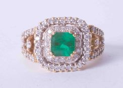An impressive & ornate 18ct yellow gold emerald (approx. 1.50 carat) and diamond cluster ring set in
