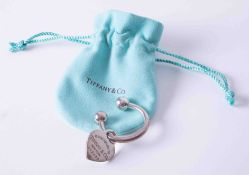 A silver Tiffany & Co heart tag keyring, weight approx. 21.7g, with Tiffany gift pouch.