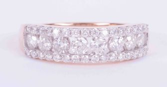 A 9ct rose gold half eternity three row ring set 1.00 carats total weight of Canadian round