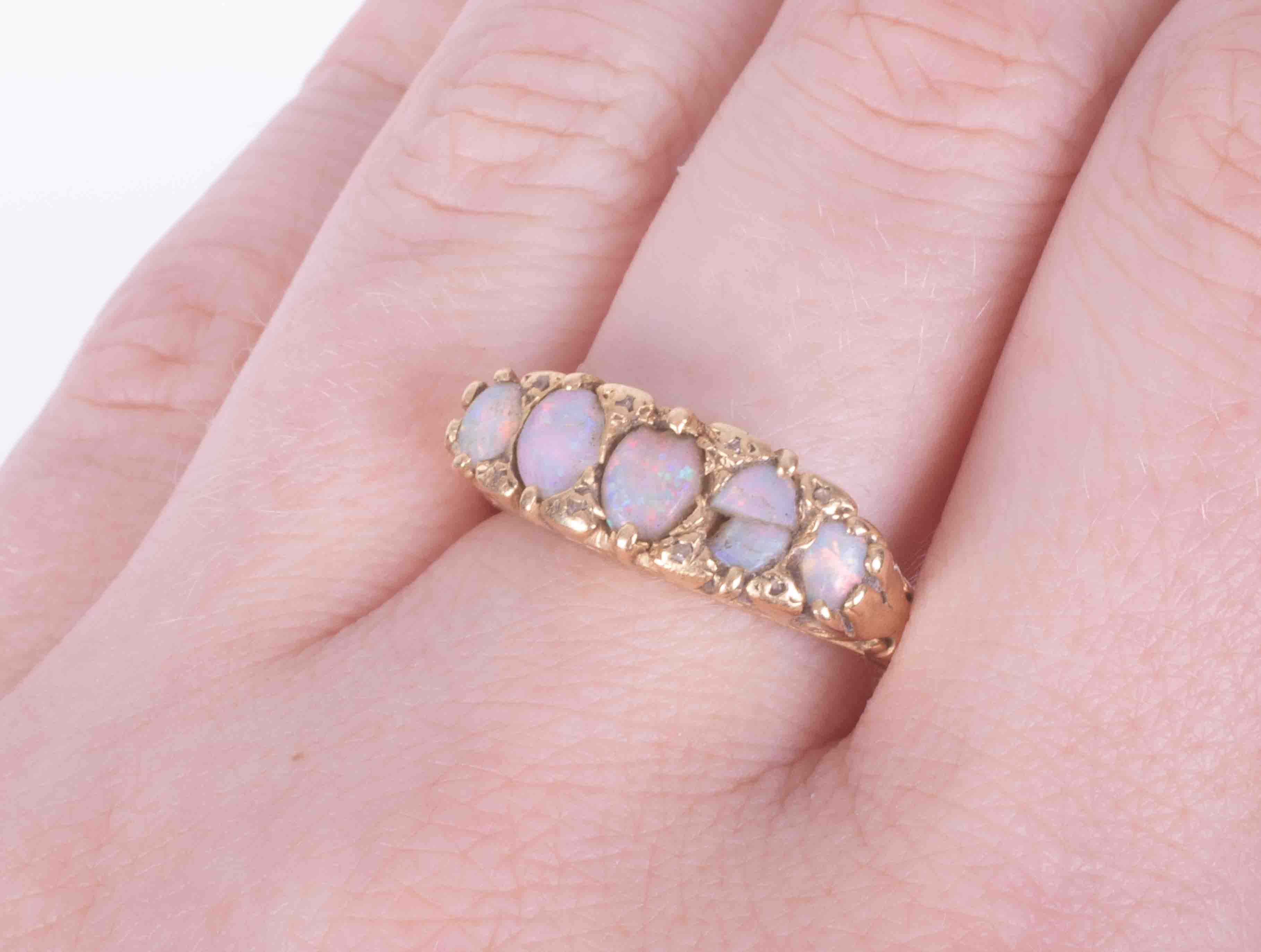 An antique 18ct yellow gold scroll design five stone opal ring (one opal broken and damage to - Image 2 of 2